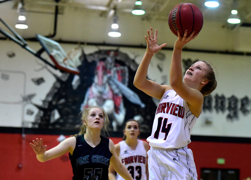 . Fairview High School\'s Izzy Munson drives to the hoop during a playoff game against Pine Creek on Friday in Boulder. More photos at dailycamera.com Jeremy Papasso/ Staff Photographer 02/23/2018
