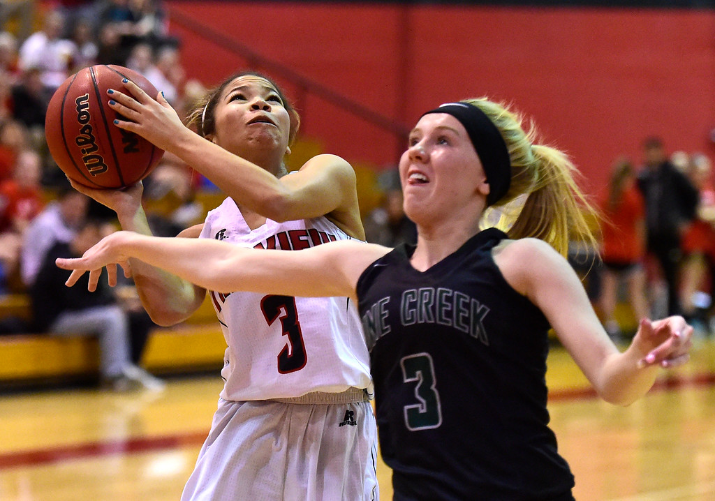 . Fairview High School\'s Adaya Richmond takes a shot over Brooklyn Thomas during a playoff game against Pine Creek on Friday in Boulder. More photos at dailycamera.com Jeremy Papasso/ Staff Photographer 02/23/2018