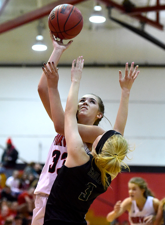 . Fairview High School\'s Kate Lampert takes a shot over Brooklyn Thomas during a playoff game against Pine Creek on Friday in Boulder. More photos at dailycamera.com Jeremy Papasso/ Staff Photographer 02/23/2018