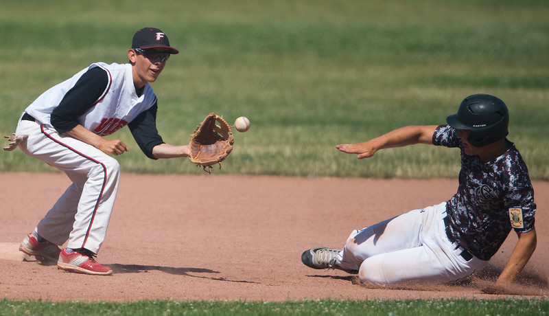 "Fairview's Johnny Garcia #8 catches the ball at second base before Silver Creek's Zach Carlough #15 slides into safety during the game at Fairview High School on Thursday. <br /> More photos:  <a href=""http://www.BoCoPreps.com"">http://www.BoCoPreps.com</a><br /> (Autumn Parry/Staff Photographer)<br /> July 14, 2016"