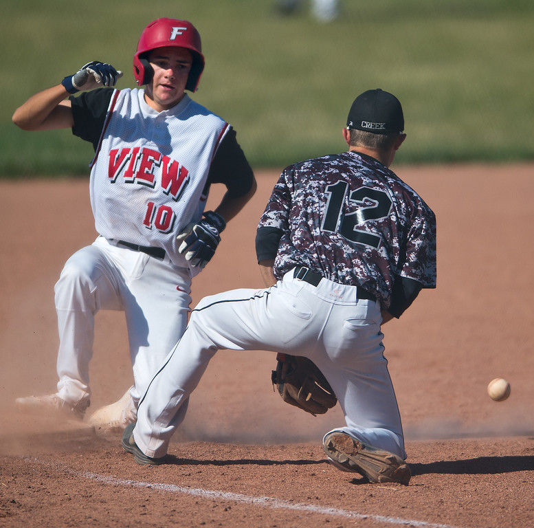 "Fairview's Cole Carrigan #10 slides safely into third base during the game against Silver Creek's  Wes Gregory #12 at Fairview High School on Thursday. <br /> More photos:  <a href=""http://www.BoCoPreps.com"">http://www.BoCoPreps.com</a><br /> (Autumn Parry/Staff Photographer)<br /> July 14, 2016"