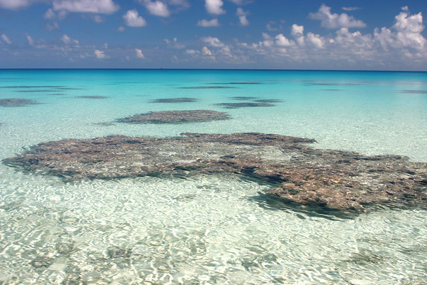 Endless Lagoon. This picture was taken on Hirifa Beach looking West. The coral gardens dot the palette of every blue imaginable.