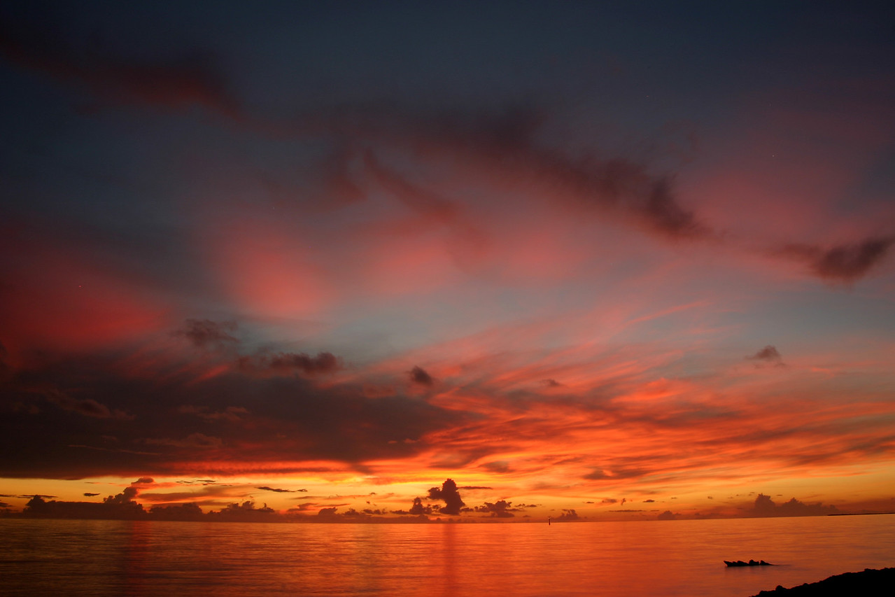 Fire in the sky. This was the sunset from our first night at Raimiti. Most of the other nights, the clouds had built up in the West so much that the sunset was much more muted.