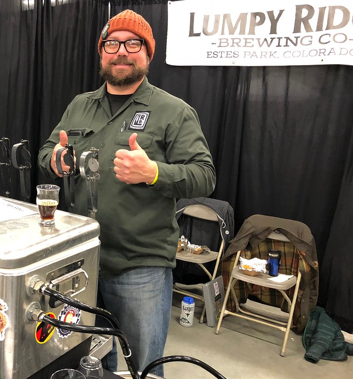 . Fall Back Beer Fest Nick Smith, owner of Lumpy Ridge in Estes Park, was happy to have people try his brews Photographer Deb Holmes