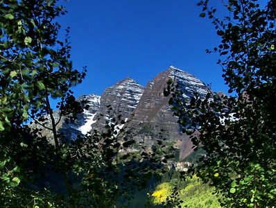 """""""Maroon Bells through the Trees""""  Look for different compositions when photographing the landscape.  Here the aspen treens provide a frame for the mountains."""