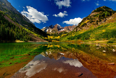 Probably the best photo I took at Maroon Bells of my three visits during the week.  This shot was taken with a Nikon D200, Nikon 12-24 f/4 lens @ 12mm, Moose Peterson warming-polarizing filter 77mm, on a Slik carbon fiber tripod with a Slik ball head.  The exposure was at f22 at 1/10th/sec with ISO 125.  If you look at some of the other shots I took earlier in the week you'll notice there are no clouds.  On Friday, clouds began to appear in the sky late in the morning.  The lake had been lined with photographers most of whom had folded up their tripods grabbed their cameras and left.  A few of us stuck around and were rewarded with these puffy white clouds to fil in the blank blue sky.  Patience is rewarding.