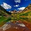 Probably the best photo I took at Maroon Bells of my three visits during the week.  This shot was taken with a Nikon D200, Nikon 12-24 f/4 lens @ 12mm, Moose Peterson warming-polarizing filter 77mm, on a Slik carbon fiber tripod with a Slik ball head.  The exposure was at f22 at 1/10th/sec with ISO 125.<br /> <br /> If you look at some of the other shots I took earlier in the week you'll notice there are no clouds.  On Friday, clouds began to appear in the sky late in the morning.  The lake had been lined with photographers most of whom had folded up their tripods grabbed their cameras and left.  A few of us stuck around and were rewarded with these puffy white clouds to fil in the blank blue sky.  Patience is rewarding.