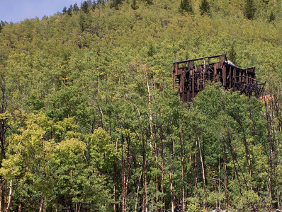 The remains of an old gold mine southeast of Aspen.  The aspen trees are just beginning to change.