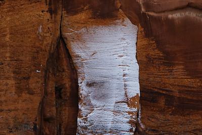 Snow on sandstone wall