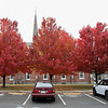 The trees behind the Pilgrim Congregational Church are on fire with color on Tuesday, Oct. 29, 2019 in Leominster. SENTINEL & ENTERPRISE/JOHN LOVE