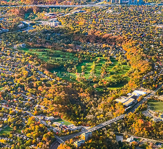 Fall foliage colors around a golf course as seen from above