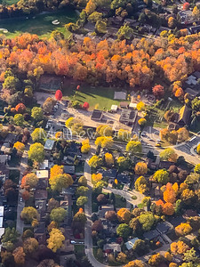 Fall colors housing neighborhood somewhere in Canada. Aerial view.