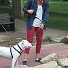 Kullen Logsdon - The Morning SunNiki Bryant walks her dog, Brutus, around Nelson Park in downtown Mt. Pleasant on Sunday Sept. 25, 2016.