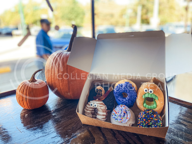 """seasonal donuts celebrating the halloween season, such as """"mummy"""" and """"spooky"""", now available at varsity donuts (Cindy Castro   Collegian Media Group)"""