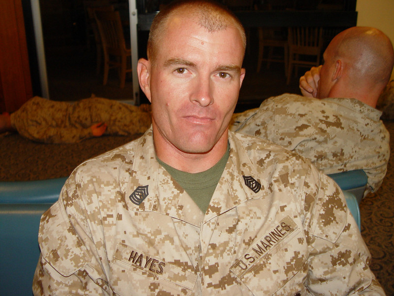 Master Sgt. John E. Hayes, 36, of Middleburg, Florida died July 8 while supporting combat operations in Helmand province, Afghanistan. He was assigned to 2nd Reconnaissance Battalion, 2nd Marine Division, II Marine Expeditionary Force, Camp Lejeune, N.C.<br /> <br /> Hayes, was the operations chief for Company A, 2nd Reconnaissance Battalion, Regimental Combat Team 3, according to a press release from II Marine Expeditionary Force. He joined the Marine Corps July 1991 and was promoted to the rank of master sergeant in September 2008.<br /> <br /> Hayes deployed to Afghanistan through Bangor, Maine on May 15th in support of Operation Enduring Freedom in April 2009. His previous deployments included Kosovo and Albania in 1998, Kuwait in 1991 and Iraq in 2003 and 2007. Hayes deployed to Afghanistan h. His previous deployments included Kosovo and Albania in 1998, Kuwait in 1991 and Iraq in 2003 and 2007.<br /> <br /> Hayes is survived by his wife, two daughters and a son. <br /> <br /> His awards include two Navy/Marine Corps Commendation Medals, three Navy/Marine Corps Achievement Medals, two Combat Action Ribbons, a Joint Meritorious Unit Award, a Navy Unit Commendation, two Navy Meritorious Unit Citations, five Marine Corps Good Conduct Medals, two National Defense Service Medals, and Armed Forces Expeditionary Medal, a Southwest Asia Service Medal, two Kosovo Campaign medals, a Global War on Terrorism Expeditionary Medal, a Global War on Terrorism Service Medal, and Armed Forces Service Medal, two Humanitarian Service Medals, six Sea Service Deployment Ribbons, a Marine Security Guard Ribbon, two NATO Medals, and the Kuwait Liberation Medal.<br /> <br /> Hayes' current duty station was Camp Lejeune and some of his formal military training included School of Infantry, U.S. Army Airborne School, Marine Combat Dive School, Marine Scout Sniper School, U.S. Army Ranger School and Marine Security Guard School.<br /> <br /> - Taken in part from the Jacksonville Daily News
