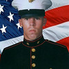 "Marine Lance Cpl. Daniel M. McVicker 20, of Alliance, Ohio died from an improvised explosive device while conducting combat operations against enemy forces near Al Qaim, Iraq. He was assigned to Combat Service Support Detachment 21, 2nd Force Service Support Group, II Marine Expeditionary Force, Cherry Point, North Carolina. As part of Operation Iraqi Freedom he was attached to Regimental Combat Team 2, 2nd Marine Division, II Marine Expeditionary Force (Forward). He died on October 6, 2005.<br /> <br /> The day of the funeral turned out clear and sunny. It was the second week of October 2005, the first hint of autumn in the air, and those who came to say goodbye to Lance Cpl. Daniel McVicker bundled themselves against the chill.<br /> <br /> McVicker had been outgoing and popular at West Branch. He wore earrings and loved fast cars. He sang in musicals - Guys and Dolls, The Wizard of Oz, Grease. He stayed active in the school concert choir, Young and Alive. During senior year, he served as one of the school's mascots, the assistant Warrior Chief. ""Everybody loved him,"" said classmate Shawna Morrow, Wade's wife.<br /> <br /> His parents said he had volunteered several times for duty in Iraq. Finally, in late August 2005, the Marines sent him. Less than two months later, a roadside bomb detonated under the Humvee he was driving near al-Qaim, in western Iraq. The explosion killed McVicker and another Marine from Alabama. Both men were 20. It happened Oct. 6. Daniel, 10:6.<br /> <br /> The young man, ""his face like lightning, his eyes like flaming torches,"" was gone. ""So many ifs,"" said Mark McVicker, Daniel's father, ""so many could-have-beens ..."" By coincidence, Tim Hardy returned home from Iraq the day word came of McVicker's death. He showed up to the funeral in his dress blues. Osberg had seen McVicker only a week earlier in Iraq, just by chance. They ate lunch together, said their goodbyes. Like Hardy, Osberg had come home with his unit. But he couldn't bring himself to attend the funeral. ""I just didn't know if I could actually show up,"" he says. ""I feel kind of bad.""<br /> <br /> At her brother's service, Mollie McVicker read a poem. ""You've borne your burdens well,"" read one line. ""Walk peacefully on heaven's streets; you've done your time in hell.""<br /> <br /> Hundreds of residents lined the road along the four-mile route to the cemetery. They wrapped themselves in green West Branch Warriors blankets and waved flags as the procession passed. Old soldiers stood outside the VFW hall and saluted. People held homemade signs like the one that read ""See U in heaven."" Firefighters parked two bright red engines along the route, extended their ladders and draped a huge American flag above the road.<br /> <br /> Stores along State Street locked their doors so employees could join in. ""Thank you, Danny,"" read the sign outside the Rite-Aid. ""God bless you, Danny,"" read the one outside Custom Auto World. ""We had lost somebody we knew,"" said Weingart, the West Branch superintendent. <br /> <br /> Carey Meissner, McVicker's mother, remembers how moved she felt that so many people showed up. McVicker's father said he had never seen such a crowd. Not far from the high school, the procession turned into a cemetery off U.S. 62 and stopped by a grave in the veterans section. <br /> <br /> Daniel McVicker got his parade."