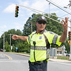 A very large tree fell across High Street in Leominster on Thursday. National Grid was on scene to turn off the power because the tree had hit the power lines. The power having to be turned of caused the traiffic lights to be out at the intersection of High Street and North Main Street. Retired Patrolman Frank Bangrazi was called in to help with the traffic. SENTINEL & ENTERPRISE/JOHN LOVE