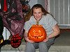 Anna with her creation (Halloween on our porch)