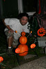 Michael posing with his creation (Halloween on our porch)