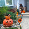 Thomas and Kati's Jack o'lanterns are in the foreground (Post-Halloween Porch)