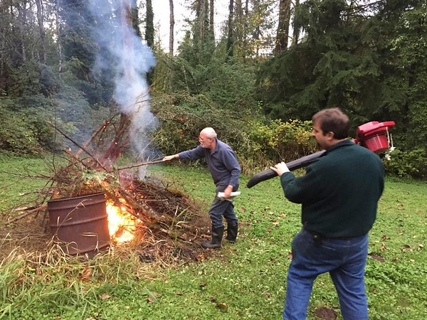 Keri: Fall in Seattle -- {Stephen} using a leaf blower and heat gun to start the bonfire. (Morgret Pic)