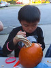 Keegan getting ready to pop the top (Pumpkin Carving on the Court)