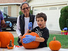 Grandma Lai with CJ in his over-sized gloves (Pumpkin Carving on the Court)