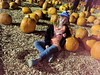 Nicole kickin' it at the pumpkin patch (Dell Osso Farms)