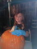 Nicole carving her pumpkin. Kat says she was staring atthe tv, not looking like a sad elf (Kati Pic)