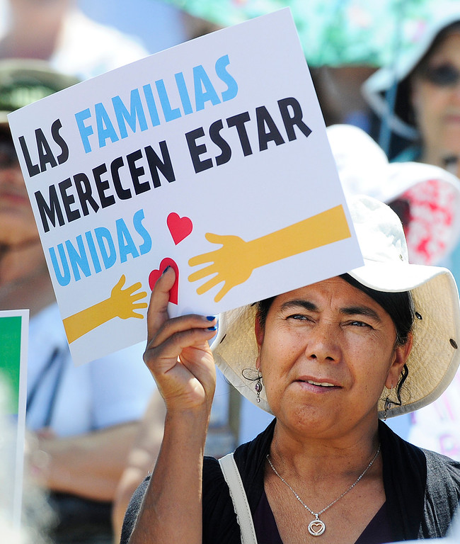 . VALLEJO, CA - JUNE 30, Protestors hold signs during the Families Belong Together rally in front of the JFK Library on Saturday in Vallejo.The rally took place with thousands of others nationwide.(CHRIS RILEY/TIMES-HERALD)