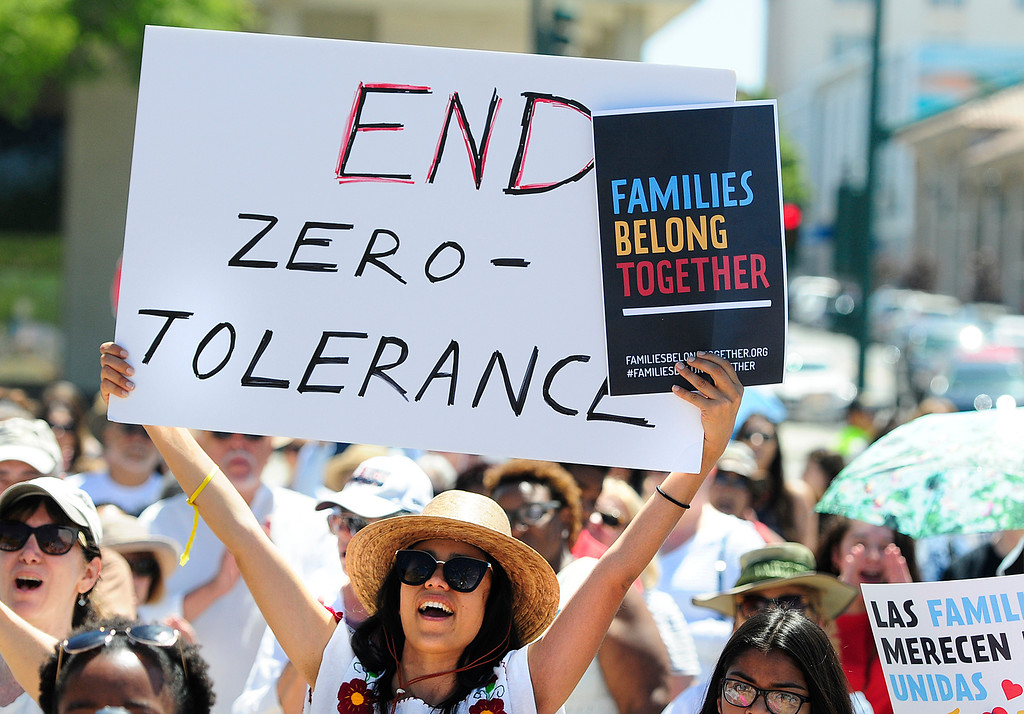 . VALLEJO, CA - JUNE 30, Graciela Rodriguez, of Napa, yells as she holds a sign during a rally on Saturday in Vallejo in front of the JFK Library to protest President Trump\'s immigration policies during the Families Belong Together. The rally took place with thousands of others nationwide. (CHRIS RILEY/TIMES-HERALD)