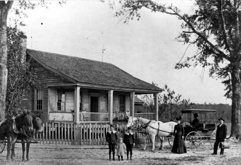 James B. and Fannie Baskin family at the home located on the Howard Boyett farm in today's Lanier County. Left to right: Armstrong B., J Hajan, Ernest L, Fannie and James B. Baskin.<br /> Photo courtesy of Bob Pierce