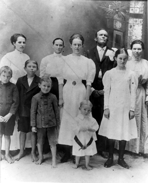 Augustus Bridges Family<br /> Back row l to r: Belle Bridges, Seanie Bridges, Augustus Bridges, Tincia Bridges<br /> Middle row l to r: Crum Bridges, Gussie Bridges, Eunice Bridges, Lois Bridges<br /> Front row l to r: Abner Bridges, Tom Bridges<br /> Photo courtesy of  Jackie S. Harris