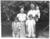 Jim and Sylvania Conger with their three children Velma_Geneva_Sara_ Picture made in West Berrien Community_Ebenezer Church_1938