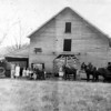 The Sam T. Lanier farm and family, about 1930. Left to right: Unidentified, Carrie, Essie Kate, Vassie, Nora wife of Sam holding Bonnie Ruth, Mary, Tommy in the wagon, and Sam Lanier.<br /> Photo courtesy of Johnny Cooper.