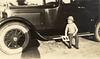 Edwin Gaskins sitting on car_circa 1927