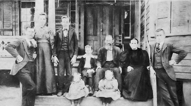 Photo taken at Bud Lindsey Place, near Pat Dove Store:<br /> L-R:  Mr. and Mrs. Jack Gray,. Ben Vicker, Lee Hobby, Mr. and Mrs. Elijah Vickers, and Leonard Vickers. Seated are Cauley Gray and Mrs. M. C. Chism, circa 1900/