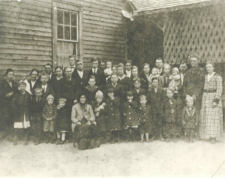 Hancock Family gathering, probably made at Christimas, 1919, at the Hancock Family home in Berrien County, Georgia. The identifications come from Alice Mc Lendon Connell, who is in the phtotograph. She was not sure of some of the identiifications because some ot the faces are not distinguishable in the photograph. She remembered the occasion, but guessed on the approximate date based on the ages of the children.<br /> <br /> Front row, left to right: Retha McLendon (in leopard coat), Clarence McLendon, Lowea McLendon, Edith Myers, Granny Mathis, Thelma Meyers(?), Texas Myers, Georgia McLendon(?), Haven Myers(?), Melvin McLendon, Landon Sirmans, June Sirmans.<br /> <br /> Second row, left to right: Maudie Lee McLendon, Nellie McLendon(?), Emma Hancock McLendon, Alice McLendon, Georgia Mathis Hancock, James Irwin Hancock, Gladys Myers, Jimmy Myers, Roger McLendon, Millie Hancock McLendon holding Verna McLendon(?), Marion McLendon, Zeke Sirmans, Euna Hancock Sirmans.<br /> <br /> Back row, left to right: George McLendon, Letty Hancock Myers, Carl Myers, Perry Hancock, Jesse Bostick holding J. L. Bostic, Effie  Hancock Bostic, Lella Bostic, Eugene Bostic, Jewell Myers, Arrel Hancock Myers holding Colin Meyers(?), Alton Meyers.<br /> <br />  Photo courtesy of Joanne Sirmans.