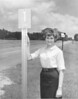 Marlynn Harnage With Milepost Marker, May 1967