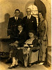 Reverend G. W. Hutchinson Family.  L-R, rear, Glen, G. W. Hutchinson, Novelle.  Front, L-R, Joseph, and Lillie Rowan Hutchinson