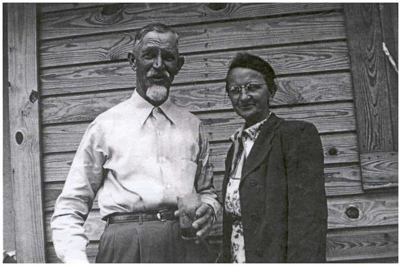 Fisher Jones 1890-1973 and Mary Griffin Jones 1901-1983 in 1956. Their children are Carlton, Katie Mae, Ina, Robert, Billy, Eugene, Mamie Lee, Letha Marie, Rachel, Martha, Wm. Irvin, Charles, Marjorie, and Randall. Fisher was the son of Irwin and Jency Gaskins Jones. Mary's parents were Hamp and Rachel Rowan Griffin. (see Griffin gallery)