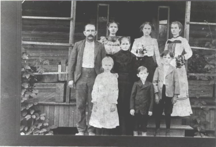 """Family of William M. Lott, born May 14, 1865, died May 7, 1931 & Harriett """"Hattie"""" Tally Lindsey, born October 11, 1860, died July 19, 1943.<br /> Children are believed to be  ( not in the correct order )<br /> 1. Lucy Virginia """" Ocia"""" Lott, born April 1888<br /> 2. William Horton Lott, born January 17, 1891, died December 9, 1959.<br /> Some of his children are:<br /> Katie Vivian Lott Jones<br /> Florence Lott Sumner<br /> James Olin Lott<br /> Hattie Lucy Lott Tomlinson<br /> Judge Hansel William(H.W.)Lott Alapaha Circuit<br /> 3. Mattie Belle Lott Allen, born February 1892, died August 21, 1967<br /> 4 John Arter Lott, born June 21, 1896, died May 18, 1941<br /> 5. Arthur Lott<br /> 6. Sally Faye Lott Clanton, born February 26, 1885, died May 29, 1924<br /> ( Sallie is the small girl on the back row beside her father)<br /> Some of her children are:<br /> Hortense Sibble Clanton McNabb ( Mother of Faye McNabb Moore )<br /> Comer Mamie Clanton Evitt<br /> Carruth Newton """"Jug """" Clanton<br /> Hattie Belle Clanton Davis<br /> Infant Clanton<br /> Robert Lovette """"R.L."""" Clanton<br /> (Photo courtesy of Faye Moore)"""
