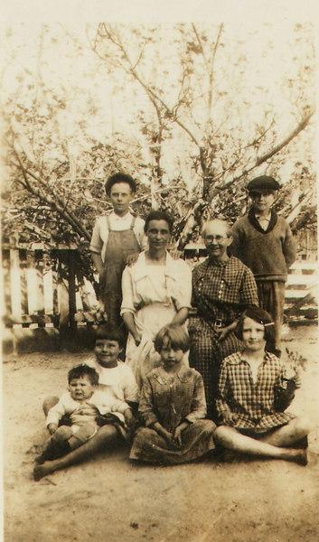 L-R, back, J. R. McKinnon, son of Lillian NeSmith and Charles McKinnon, Lillian NeSmith McKinnon, Sally McMillan Moore, Olin Moore.  Seated, L-R, Carrie Ella McKinnon, daughter of Lillian NeSmith and Charles McKinnon, Evelyn Moore, Emma Moore, and baby, Sarah Myrtice McKinnon (1923-1926), circa 1925.
