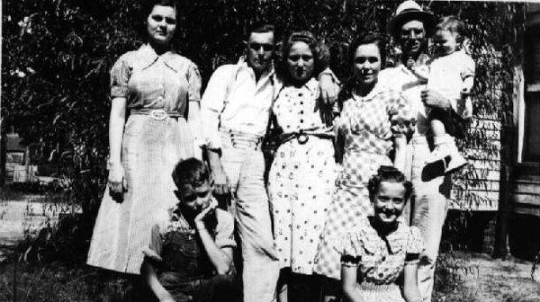 L-R, front, Askew Kirkland, son of Martha Alice Bailey and Lonnie Kirkland, and Lillian Eugenia McKinnon. daughter of Charles and Louella NeSmith McKinnon.  Back row, L-R:  Carrie Ella McKinnon Bailey, daughter of Charles and Louella NeSmith McKinnon, and wife of James Seaborn Bailey, Neal Duren Bailey, son of Frederick Wesely and Martha Jane Barber Bailey, Alma Avera, daughter of William Henry and Mackie Nichols Avera, Lillian Bailey Parker, daughter of Frederick Wesley and Martha Jane Barber Bailey, and Earl Parker, holding Lillian and Earl's daughter, Barbara.  (circa 1939)