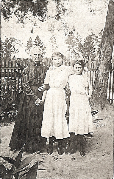 "Sarah ""Aunt Sadie"" McKinnon McRae, wife of William McRae, and daughter of Lauchlin and Mary Ann (Pierce) McKinnon; Bell Turner Taylor, and unknown girl, circa early 1900's."