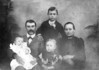 "Edwin Tally Morris family, taken about 1902. Edwin Morris is holding Albert Lanier Morris, Ona Belle Morris center, Kansas Ann (Futch) Morris on the right. Thomas McIntyre ""Mac"" Morris is standing. Photo courtesy of Olivia (Matthis) Boyette."