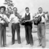 """The """"Noles Boys"""" about 1930.<br /> Left to right: Elmer Noles, Floyd Noles, Emond Noles, and Alvin Noles.<br /> From Milltown when it was still part of Berrien County. Elmer, Floyd, and Alvin were all brothers, sons of Ben Hill Noles. Edmond was their nephew, son of Ed Noles.<br /> Photo courtesy of Faith Noles"""