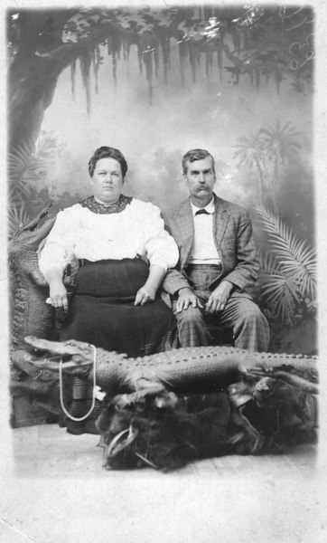 W. Bartow Parrish and his wife Ida Jane Shaw Parrish in studio photograph using stuffed alligator.