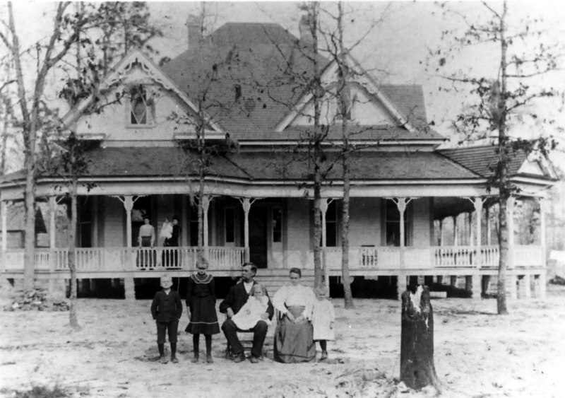 Samuel R. Patten family and home about 1905. Left to right in foreground: George Patten, Effie Patten (Eason), Samuel R. Patten, Dolly Patten (Cooper) in his lap, Matilda M. Patten, and Estelle Patten (Leverett). Individuals on porch unidentified. Photo courtesy of Martha Cooper Blanton