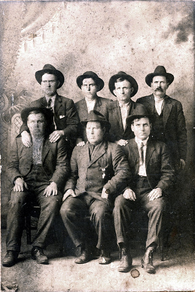Seven of the eight Purvis Brothers of north Berrien County, about 1910.<br /> Top row, left to right: Elbert, Boy Virgil, Jake, Henry<br /> Bottom row, left to right: Oscar, Thomas, James. <br /> The oldest of the eight brothers was John, who was killed when he was knocked off his horse <br /> by a pine tree at the age of 21.